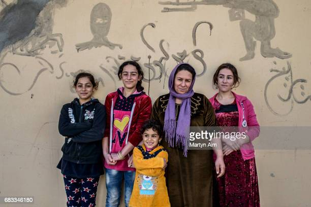 Saida an Iraqi Kaka'i woman and her four daughters Lubna Beriwan Lina and Luma stand in front of their family home in the village of Wardak in the...