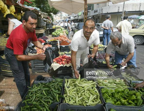Lebanese citizens stock up on vegetables in Saida souk 40km south of Beirut 16 July 2006 as the Israeli bombardment continued for a fifth day Israeli...