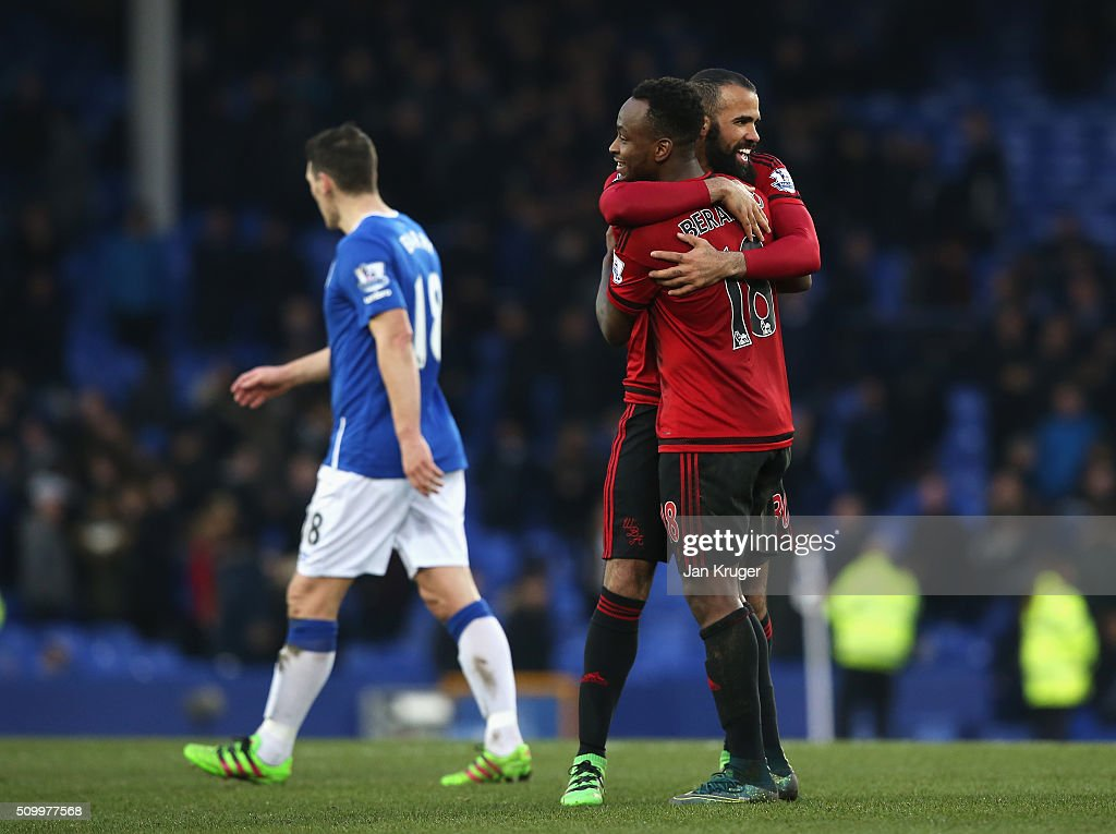 Saido Berahino and Sandro of West Bromwich Albion celebrate their 1-0 win in the Barclays Premier League match between Everton and West Bromwich Albion at Goodison Park on February 13, 2016 in Liverpool, England.