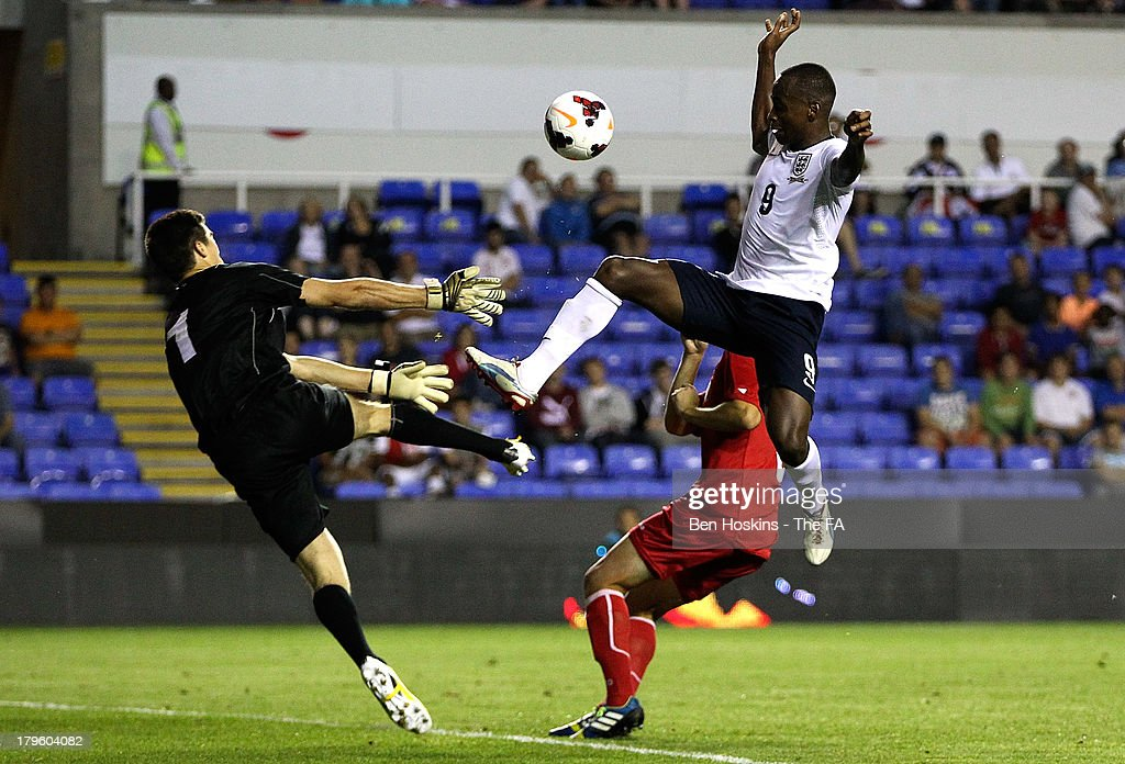 Saido Berahino #9 of England and goalkeeper Alexi Koshelev of Moldova in action during the 2015 UEFA European U21 Championships Qualifier match between England U21 and Moldova U21 at Madejski Stadium on September 5, 2013 in Reading, England.