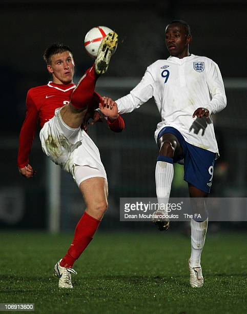 Saido Berahino of England and Krystian Zolnierewicz of Poland battle for the ball during the International friendly match between England U18 and...