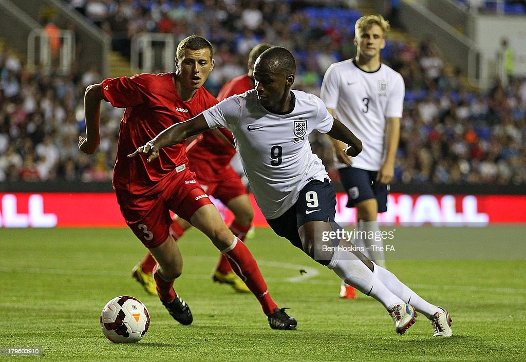 Saido Berahino of England (R) in action against Maxim Focsa of Moldova during the 2015 UEFA European U21 Championships Qualifier match between England U21 and Moldova U21 at Madejski Stadium on September 5, 2013 in Reading, England.
