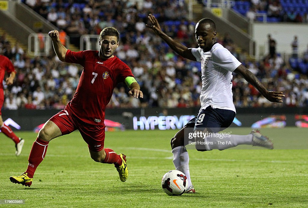 Saido Berahino of England (R) takes a shot at goal past Eugen Zasaviitchi of Moldova during the 2015 UEFA European U21 Championships Qualifier match between England U21 and Moldova U21 at Madejski Stadium on September 5, 2013 in Reading, England.