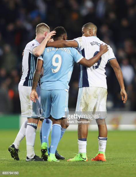 Saido Berahino of Stoke City and Jose Salomon Rondon of West Bromwich Albion embrace after the Premier League match between West Bromwich Albion and...