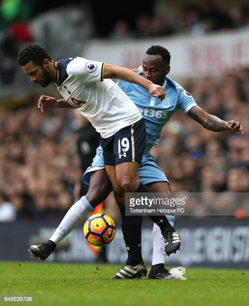 Saido Berahino of Stoke City and Mousa Dembele of Tottenham Hotspur challenge for the ball during the Premier League match between Tottenham Hotspur...