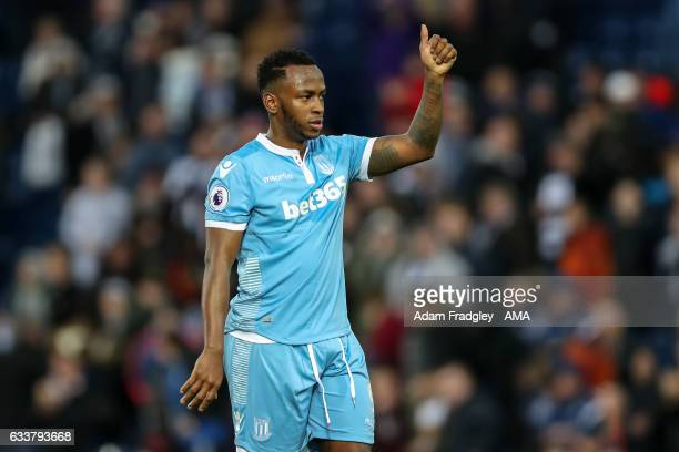 Saido Berahino of Stoke City gives a thumbs up at the end of the match to the travelling fans of Stoke City during the Premier League match between...