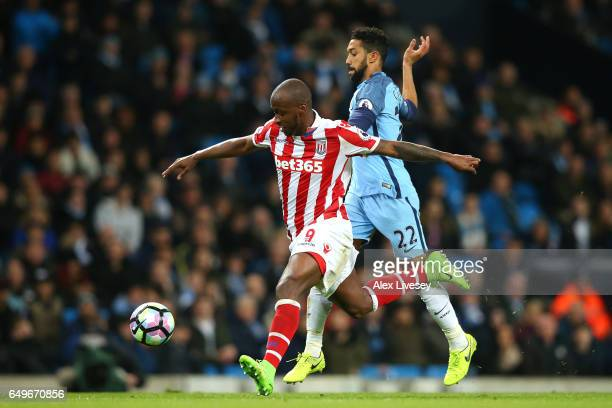 Saido Berahino of Stoke CIty is chased by Gael Clichy of Manchester City during the Premier League match between Manchester City and Stoke City at...