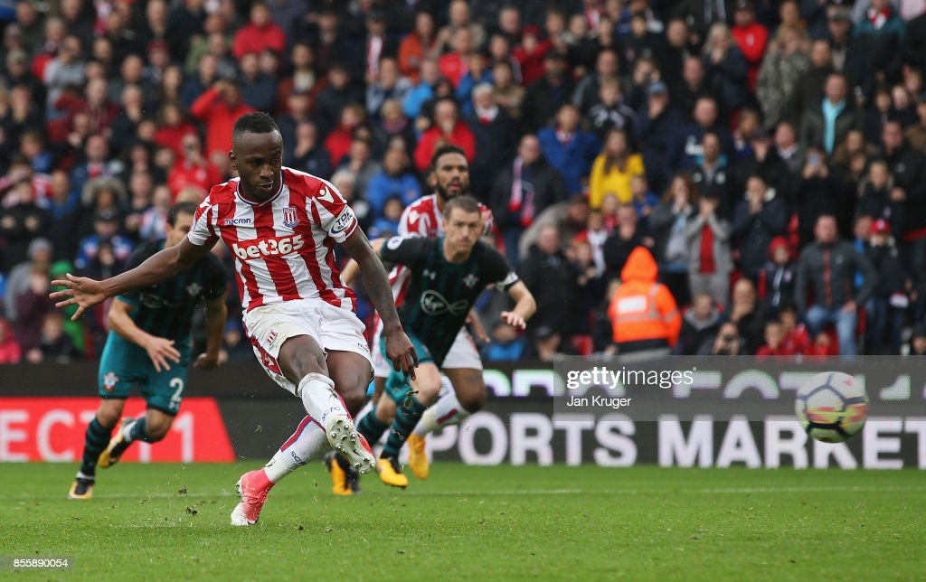 Saido Berahino of Stoke City takes a penalty which is saved by Fraser Forster of Southampton during the Premier League match between Stoke City and Southampton at Bet365 Stadium on September 30, 2017 in Stoke on Trent, England.