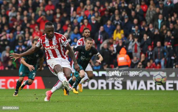 Saido Berahino of Stoke City takes a penalty which is saved by Fraser Forster of Southampton during the Premier League match between Stoke City and...