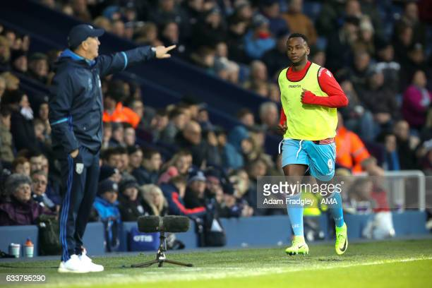 Saido Berahino of Stoke City warms up along the touch line infront of his former manager Tony Pulis head coach / manager of West Bromwich Albion...