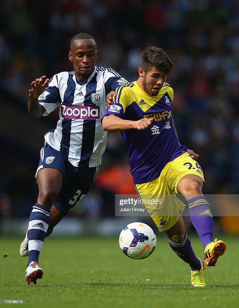 Saido Berahino of West Brom and Alejandro Pozuelo of Swansea battle for the ball during the Barclays Premier League match between West Bromwich Albion and Swansea City at The Hawthorns on September 01, 2013 in West Bromwich, England.