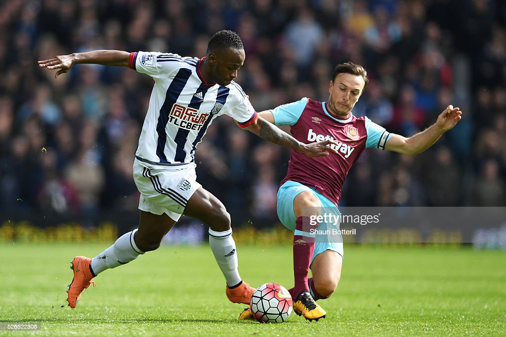 Saido Berahino of West Bromwich Albion and Mark Noble of West Ham United compete for the ball during the Barclays Premier League match between West Bromwich Albion and West Ham United at The Hawthorns on April 30, 2016 in West Bromwich, England.