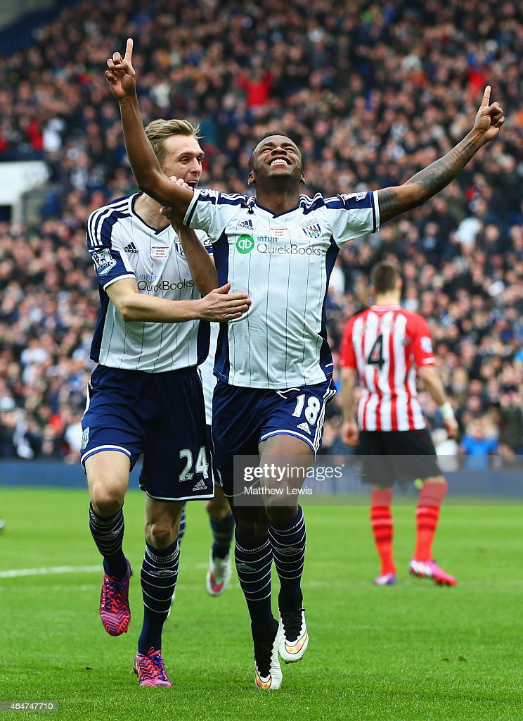 Saido Berahino of West Bromwich Albion celebrates with Darren Fletcher as he scores their first goal during the Barclays Premier League match between...