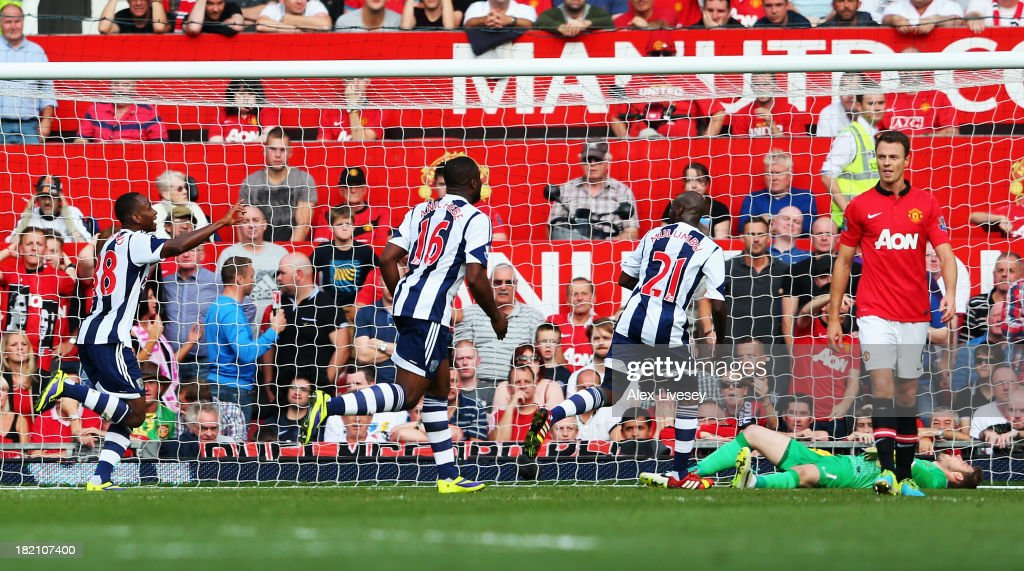 Saido Berahino (L) of West Bromwich Albion celebrates with team mates after scoring during the Barclays Premier League match between Manchester United and West Bromwich Albion at Old Trafford on September 28, 2013 in Manchester, England.