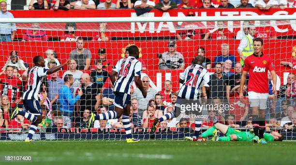 Saido Berahino of West Bromwich Albion celebrates with team mates after scoring during the Barclays Premier League match between Manchester United...