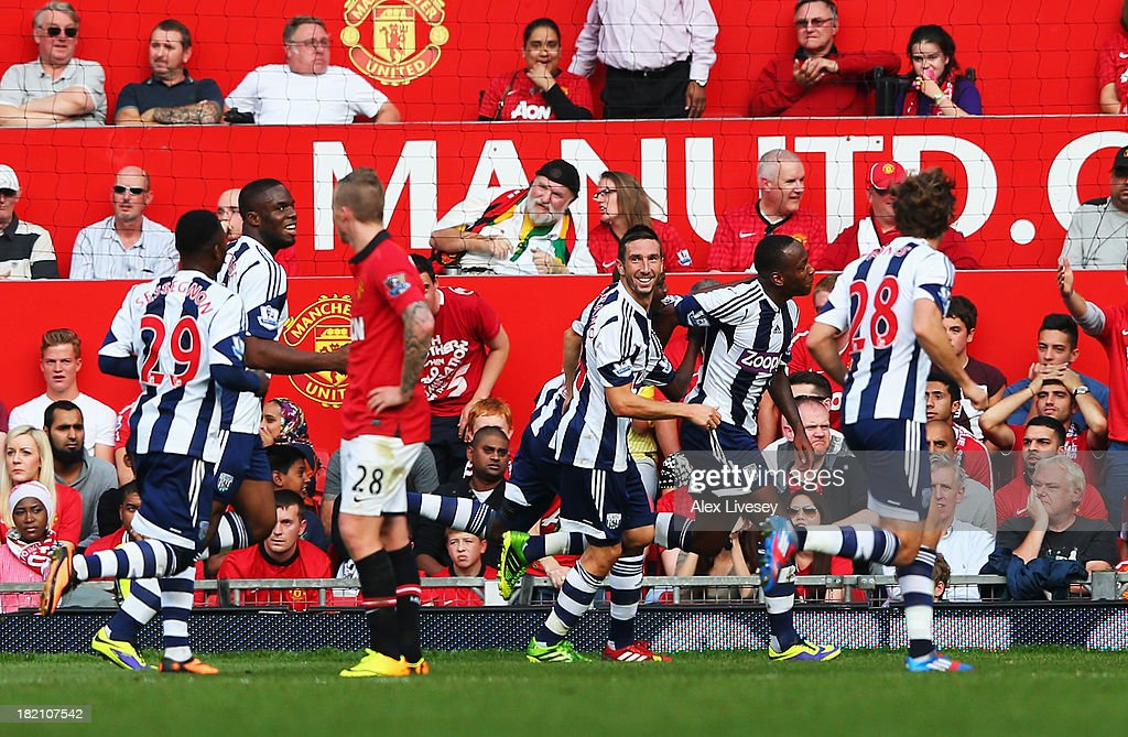 Saido Berahino (2nd right) of West Bromwich Albion celebrates with team mates after scoring his sides second goal during the Barclays Premier League match between Manchester United and West Bromwich Albion at Old Trafford on September 28, 2013 in Manchester, England.
