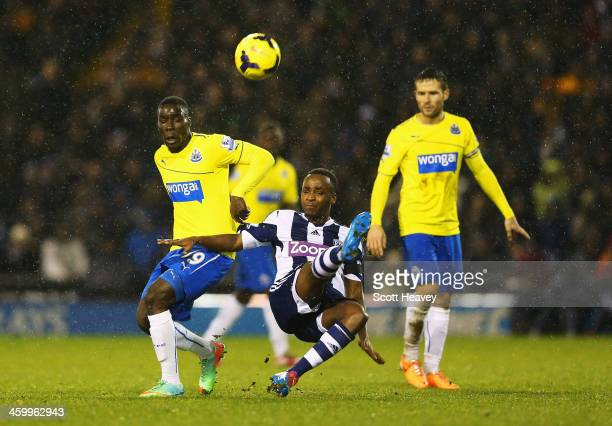 Saido Berahino of West Bromwich Albion challenges for the ball with Massadio Haidara of Newcastle United during the Barclays Premier League match...