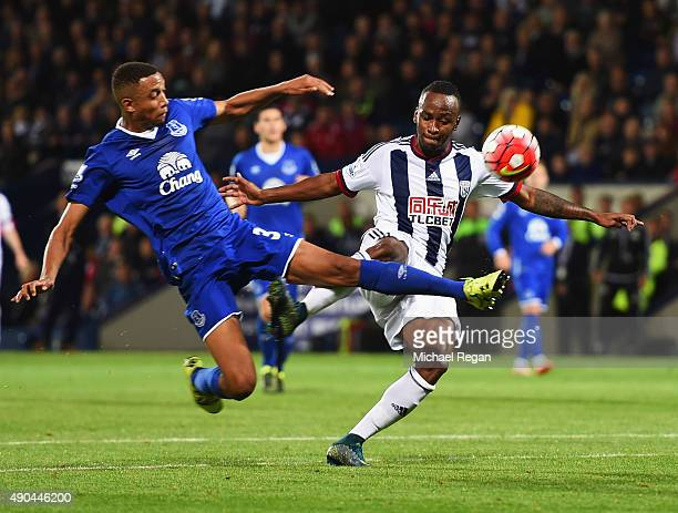 Saido Berahino of West Bromwich Albion is challenged by Brendan Galloway of Everton during the Barclays Premier League match between West Bromwich...
