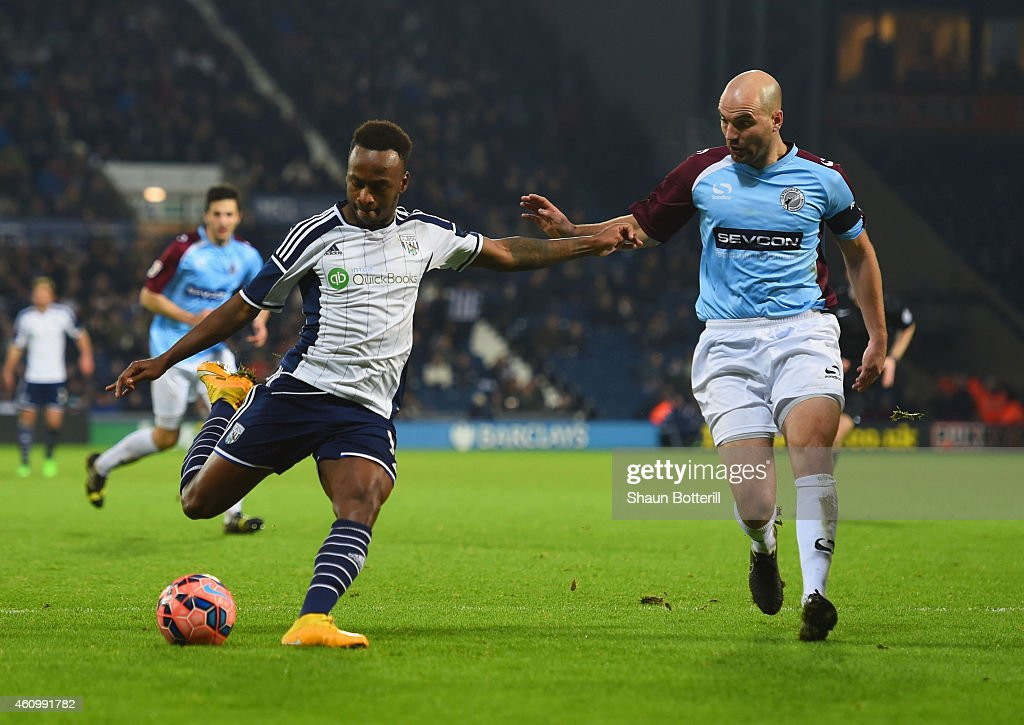 Saido Berahino of West Bromwich Albion is faced by Ben Clark of Gateshead during the FA Cup Third Round match between West Bromwich Albion and...