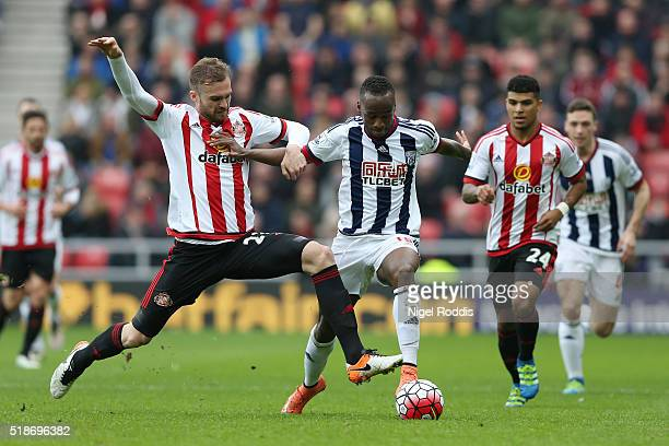 Saido Berahino of West Bromwich Albion is tackled by Jan Kirchhoff of Sunderland during the Barclays Premier League match between Sunderland and West...