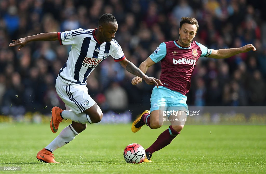 Saido Berahino of West Bromwich Albion is tackled by Mark Noble of West Ham United during the Barclays Premier League match between West Bromwich Albion and West Ham United at The Hawthorns on April 30, 2016 in West Bromwich, England.