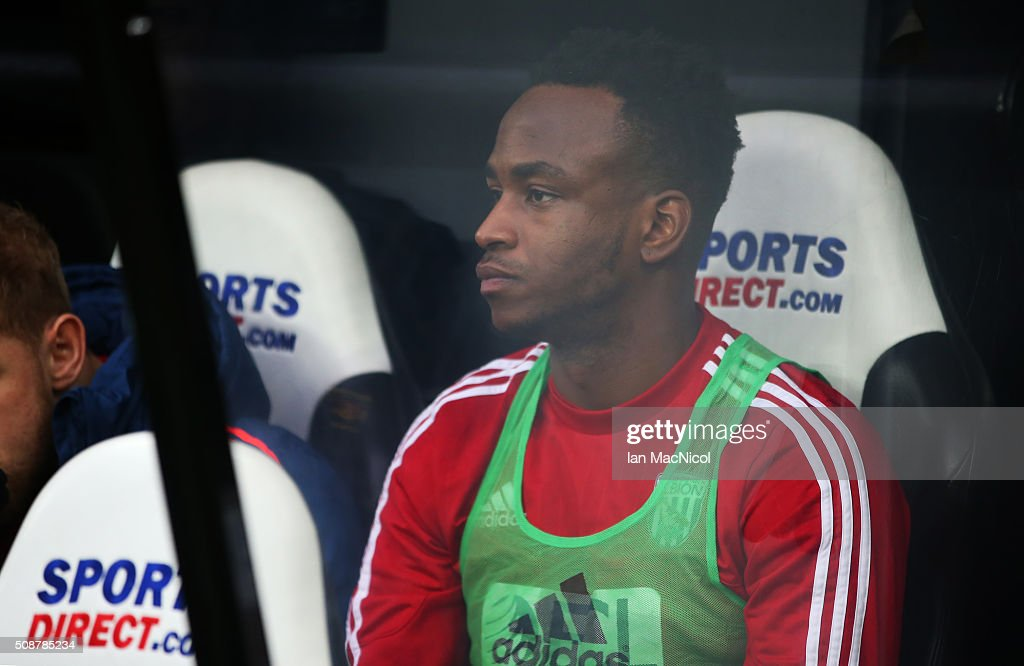 Saido Berahino of West Bromwich Albion looks on from the bench during the Barclays Premier League match between Newcastle United and West Browmich Albion at St James Park on February 6, 2016 in Newcastle, England.