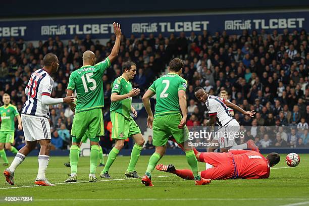 Saido Berahino of West Bromwich Albion scores his team's first goal during the Barclays Premier League match between West Bromwich Albion and...