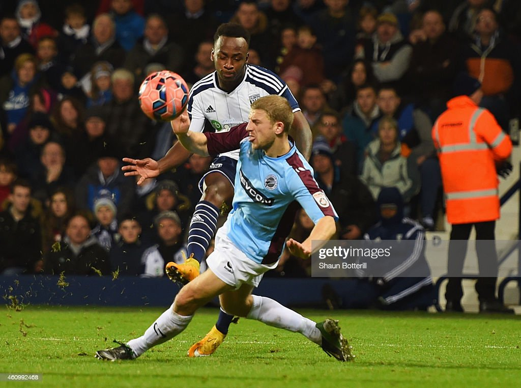 Saido Berahino of West Bromwich Albion shoots past Craig Baxter of Gateshead to score his team's seventh and his fourth during the FA Cup Third Round...