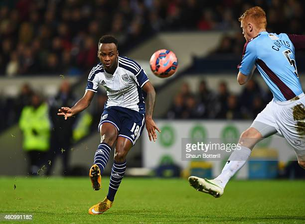 Saido Berahino of West Bromwich Albion shoots past James Curtis of Gateshead to score their third goal during the FA Cup Third Round match between...