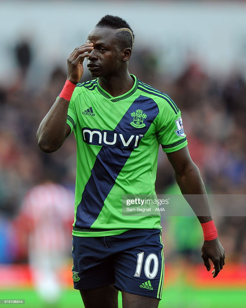 Saido Mane of Southampton looks on after being sent off during the Barclays Premier League match between Stoke City and Southampton at Britannia Stadium on March 12, 2016 in Stoke on Trent, England.