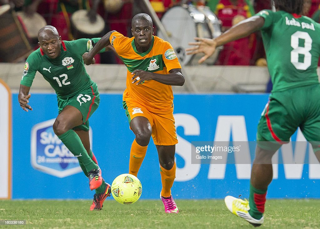 AFRICA - JANUARY 29, Saidou Mady Panandetiguiri from Burkina Faso (L) challenges Chisamba Lungu from Zambia (C) during the 2013 Orange African Cup of Nations match between Burkina Faso and Zambia from Mbombela Stadium on January 29, 2013 in Nelspruit, South Africa.