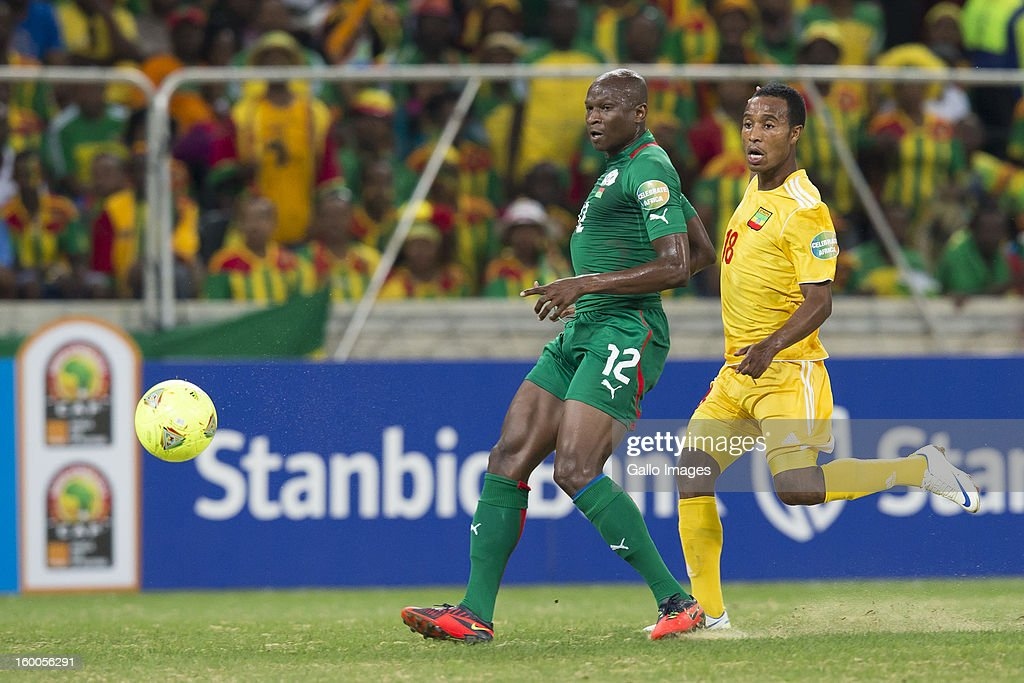 Saidou Mady Panandetiguiri of Burkina Faso (L) and Omod Okwury Omod of Ethiopia competeduring the 2013 African Cup of Nations match between Burkina Faso and Ethiopia from Mbombela Stadium on January 25, 2013 in Nelspruit, South Africa.