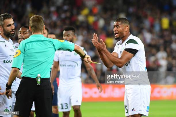 Saidy Janko of St Etienne receives a yellow card from referee Clement Turpin after conceeding a penalty during the Ligue 1 match between Paris Saint...