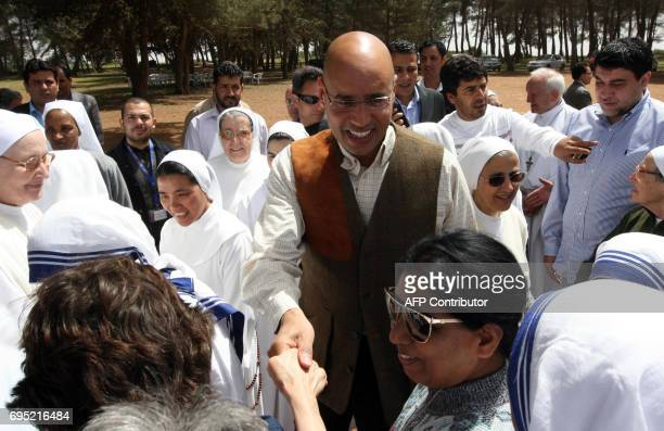 Saif alIslam son of Libyan leader Moamer Kadhafi visits nuns residing in the northern town of AlBayda during Catholic Easter celebrations on April 13...