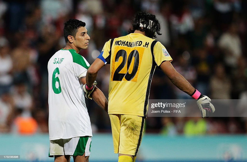 Saif Salman (L) and Mohammed Hameed of Iraq are seen disappointed after loosing the FIFA U-20 World Cup Semi Final match between Iraq and Uruguay at Huseyin Avni Aker Stadium on July 10, 2013 in Trabzon, Turkey.
