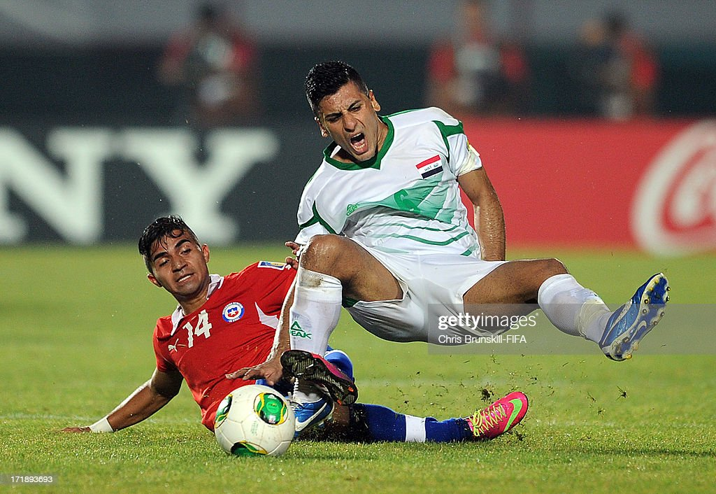 Saif Salman of Iraq is fouled by Bryan Rabello of Chile during the FIFA U20 World Cup Group E match between Iraq and Chile at Akdeniz University Stadium on June 29, 2013 in Antalya, Turkey.