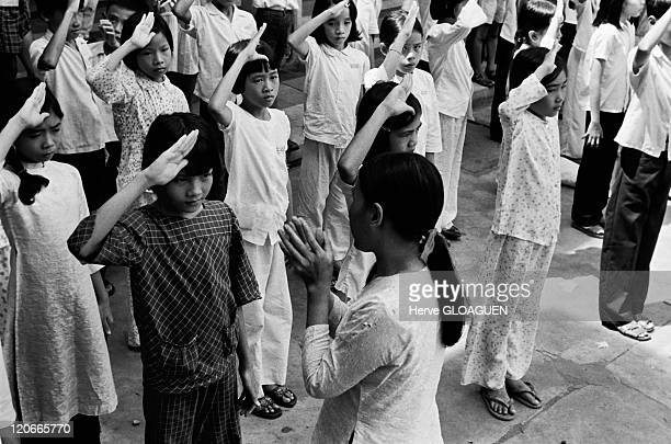Saigon in Vietnam in May 1975 After the victory of communist North Vietnam and The Fall of Saigon renamed Ho Chi Minh city the young pupils were...