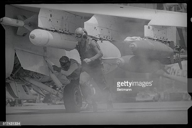 Pilots Board Their Planes A Navy plane aboard the 7th fleet carrier Constellation cruising off the Vietnam coast southeast of Saigon April 26th when...
