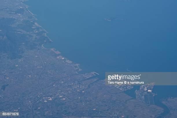 Saijo city and Seto Inland Sea, daytime aerial view from airplane