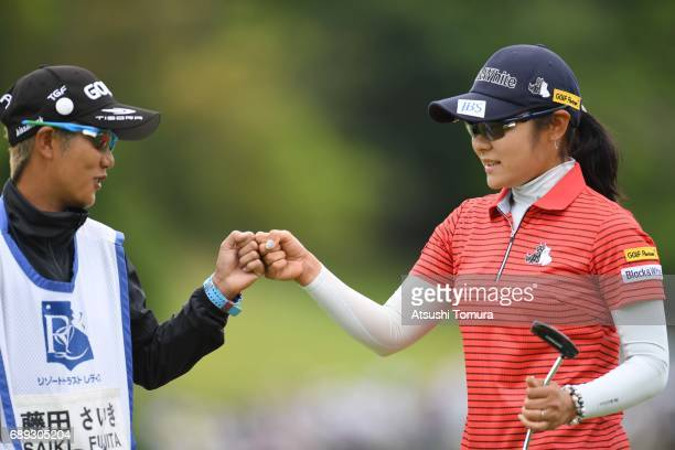 Saiki Fujita of Japan celebrates after making her birdie putt on the 3rd hole during the final round of the Resorttrust Ladies at the Oakmont Golf...