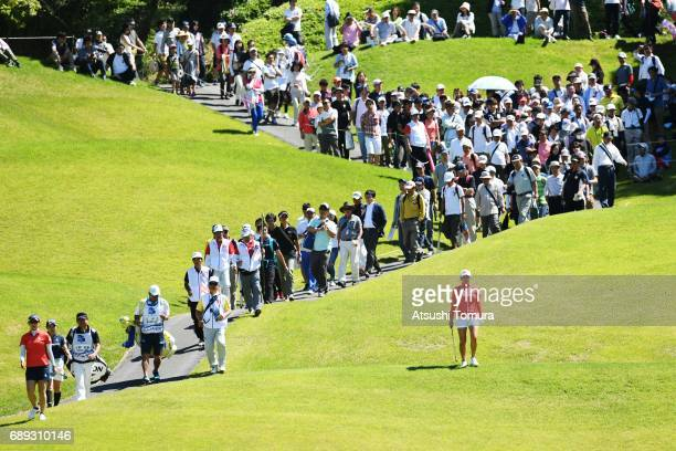 Saiki Fujita of Japan Hiromu Ono of Japan and BoMee Lee of South Korea walk on the 16th hole during the final round of the Resorttrust Ladies at the...