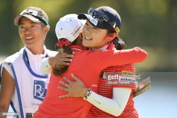Saiki Fujita of Japan hugs BoMee Lee of South Korea during the final round of the Resorttrust Ladies at the Oakmont Golf Club on May 28 2017 in...