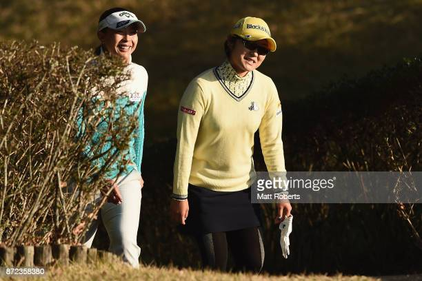 Saiki Fujita of Japan shares a laugh with Mayumi Shimomura of Japan during the first round of the Itoen Ladies Golf Tournament 2017 at the Great...