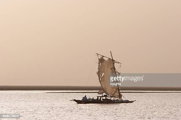 Sail boat in the sunset on Lake Debo formed by the seasonal flooding of the Niger River Mali