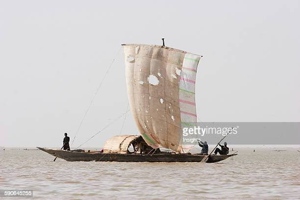 Sail boat on Lake Debo formed by the seasonal flooding of the Niger River Mali