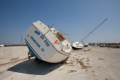 Sail boats line the road on the west end of Galveston Island almost two weeks after Hurricane Ike hit the barrier island off the Texas coast