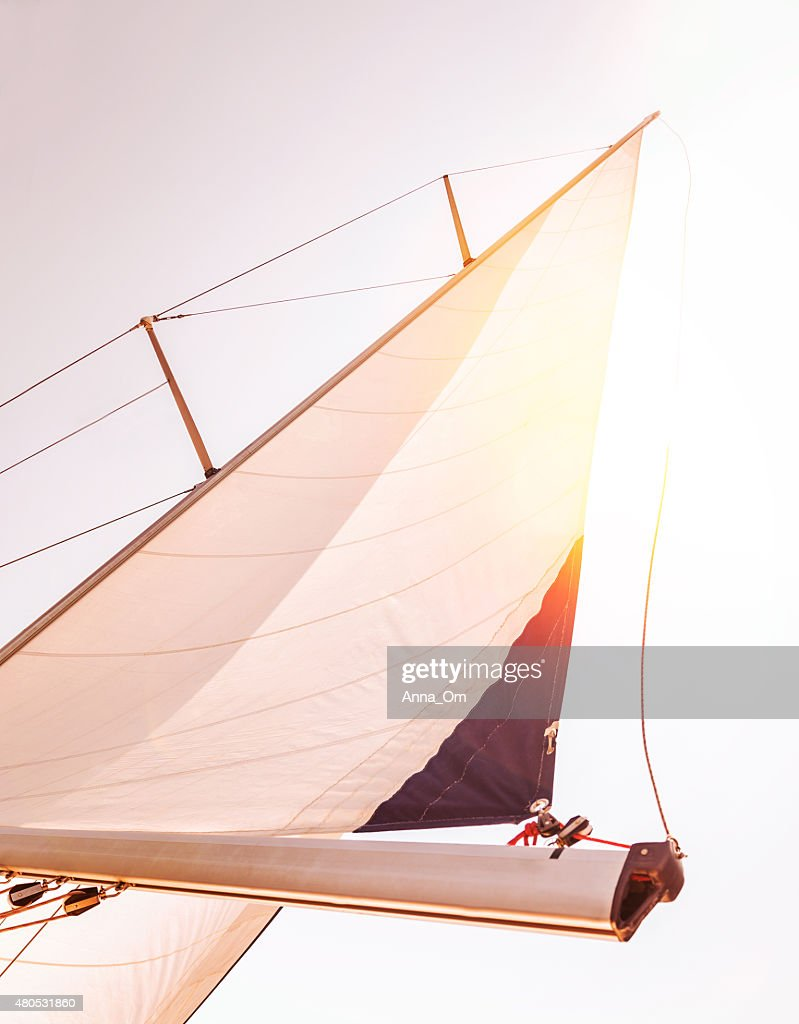 Sail over sunset sky : Stock Photo