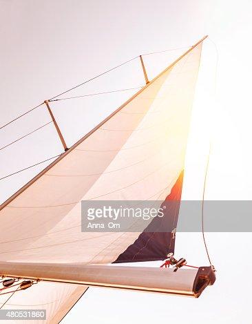 Sail over sunset sky : Stock Photo
