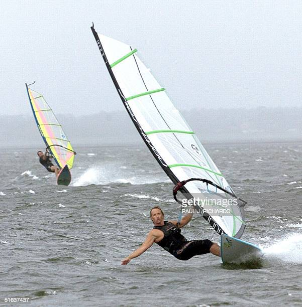 Sailboarder Joe Toner catches the wind from Hurricane Bonnie near Cape Hatteras Island in North Carolina 26 August Many storm veterans stayed in the...