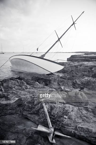 Sailboat aground on the rocks
